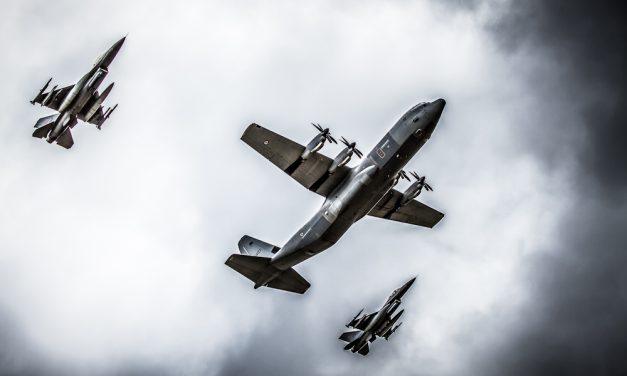 F- 16 escorting a Hercules.