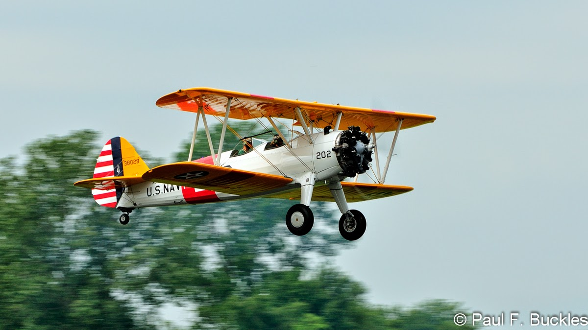 Here's a Boeing PT-17 Stearman taking off from the Mid East Regional Fly-In at Grimes Field Urbana, Ohio August 2014.