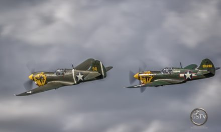 Two Curtiss P-40s Leaving Town