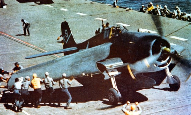 """An F6F-3 aboard USS Yorktown has its """"Sto-Wing"""" folding wings deployed for takeoff."""