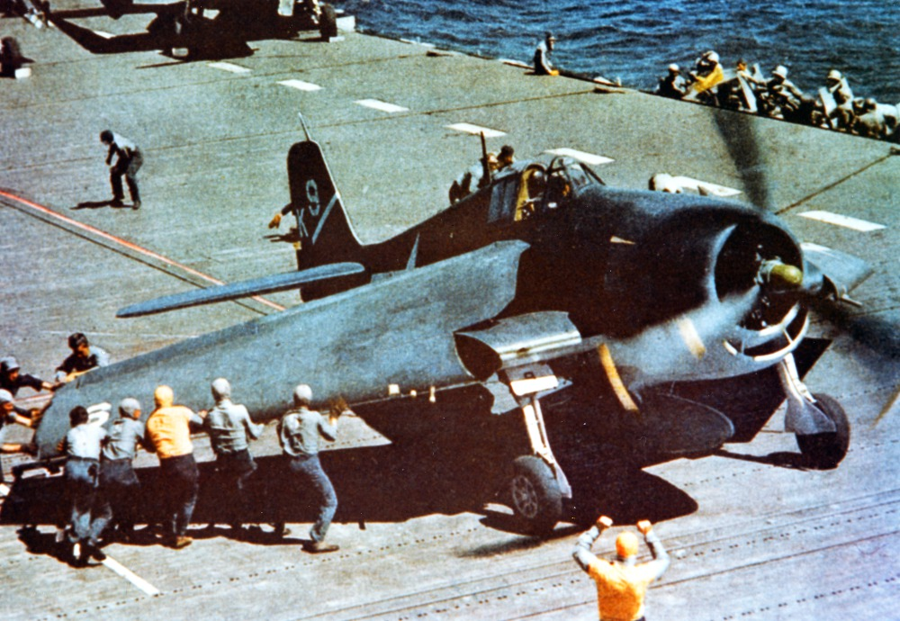 "An F6F-3 aboard USS Yorktown has its ""Sto-Wing"" folding wings deployed for takeoff."