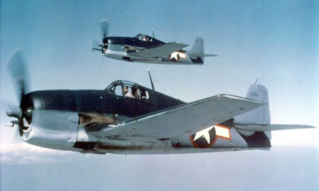 Grumman F6F-3 Hellcats in tricolor camouflage.