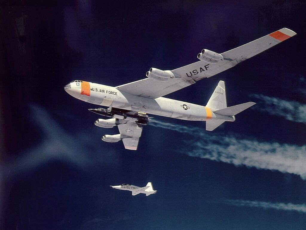 X-15 being carried by its NB-52B mothership (52-0008), with T-38A chase plane.