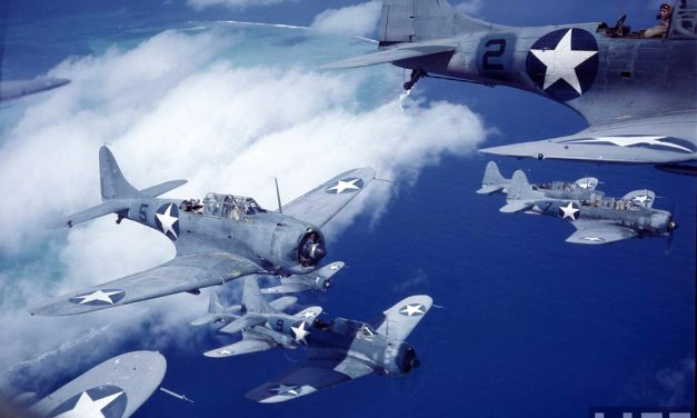 A squadron of SBD Dauntless dive bombers over the Pacific.