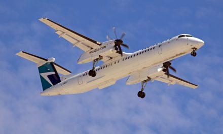 A WestJet Encore Bombardier Q400 caught on final approach to CYWG / Winnipeg.
