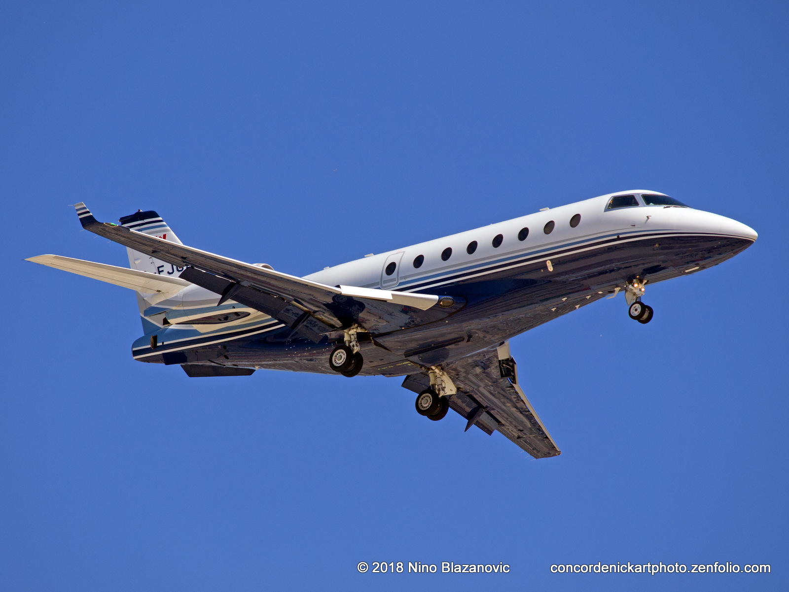 A Gulfstream G200 business jet swooping in for a landing at CYWG / Winnipeg.