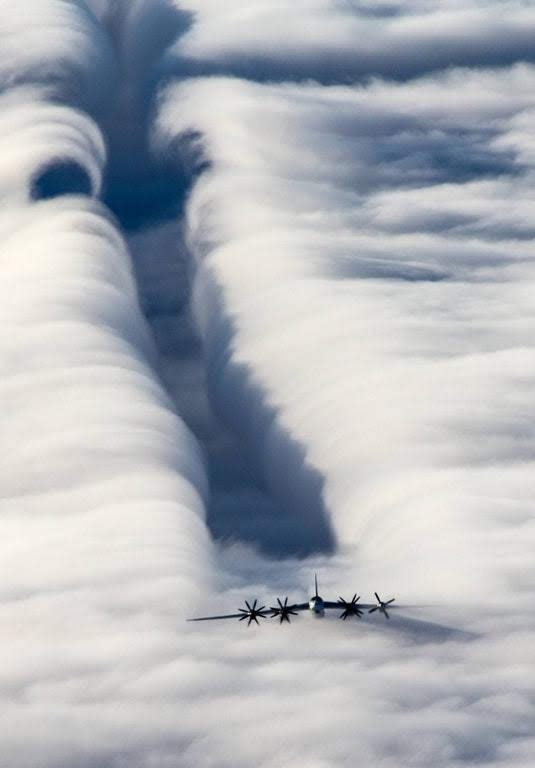 A Tu-95 flying through the clouds