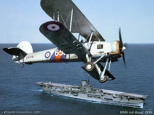 A Fairey Swordfish flies over HMS Ark Royal, 1939.