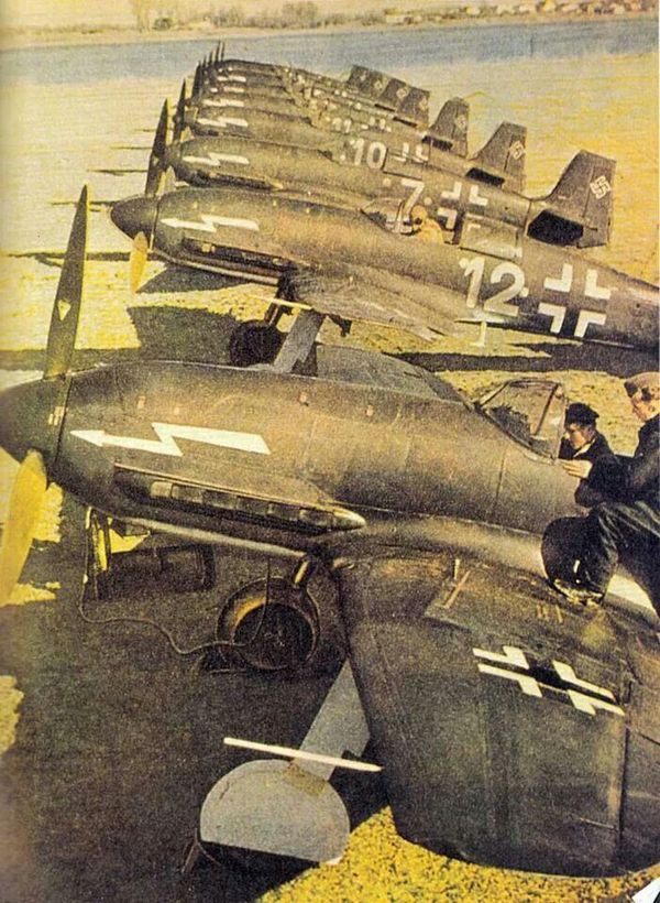"""A row of Heinkel He-100s masquerading as fictitious """"Heinkel He-113s"""", 1940."""