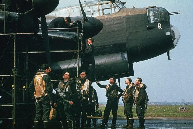 Following a test flight, the skipper of a Lancaster BI discusses an issue with the starboard inner Merlin engine, as…