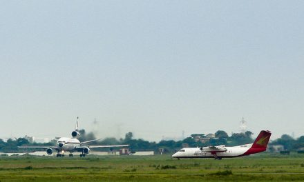 Biman's DC-10 lined up for take off from Runway 14 while the Regent Airways Bombardier Dash 8-Q311 ( S2-AHB )…