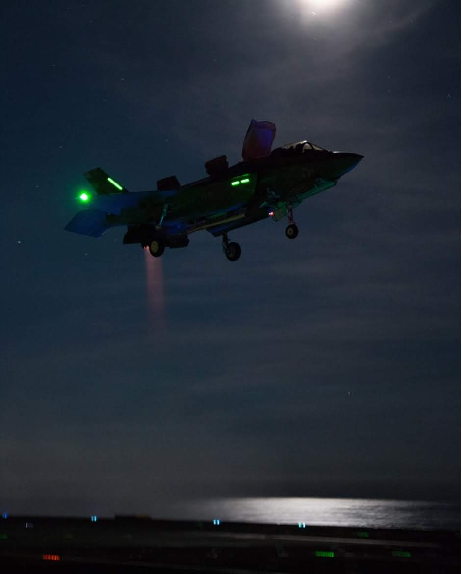 An F-35B Lightning II fighter jet taking off from the Royal Navy aircraft carrier HMS Queen Elizabeth (R08) laying…