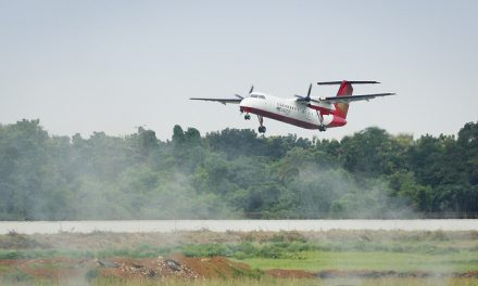 Regent Airways Bombardier Dash 8-Q311 S2-AHB takes off using Runway 14 over smoke that has been created from the…