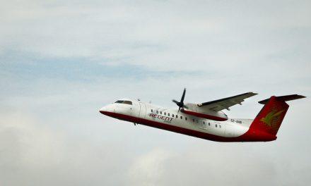 Regent Airways Bombardier Dash 8-Q311 S2-AHB takes off using Runway 14.