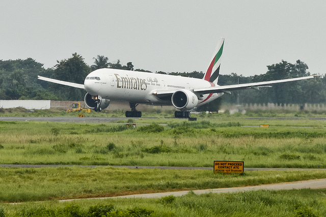 Emirates Boeing 777-31HER ( A6-EBD ) Takes off on a cloudy morning from Hazrat Shahjalal International Airport Dhaka