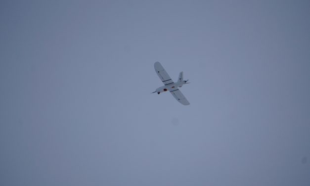 Ghost drone.  (UMN UAV lab flight testing in winter overcast hazy conditions.)